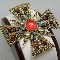 P-1670. редкость! Высоко коллекционная брошь в форме мальтийского креста от марки ART. Ювелирный сплав оттенка античного золота, декор кристаллами,кабошонами.Диаметр-7см. Маркировка, прекрасная сохранность.