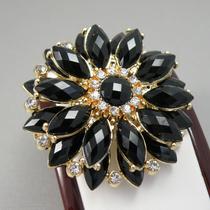 6. Красивая брошь в универсальном черном цвете. Ювелирный сплав под золото, кристаллы Сваровски. Диаметр-5см. Цена 15$