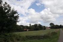 """<img src=""""image.jpg"""" alt=""""Het dorp De Waal op Texel."""">"""