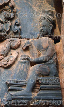 Drum player accompanying the Shiva's dance. Banteay Srei.