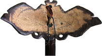 Inside a bat-shaped pirouette with outstretched wings in coconut. Notice the quadruple reed.