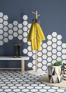 Blue and white hexagon tiles used on floors and walls.