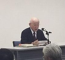 「記念講演」の武吉次朗さん