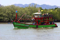 Experience fishermen in their fishing boats on a round trip in southern Thailand.