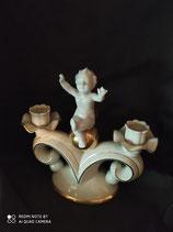 Antico Gerold&CO.Tettau portacandele cherubino
