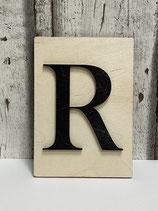 LETTERS  schwarzer Holzbuchstabe auf Unterlage Holz natur verschiedene