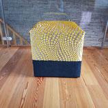 Le pouf design, noir et jaune moutarde