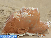 Buried movie set sphinx head uncovered