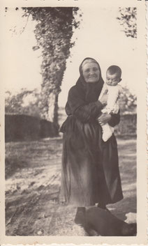 Marie Duffau holding her grandson, Jacques Delord