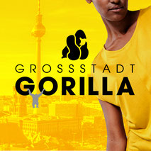 Gelbes Motiv mit Frau und einem Gorilla und der Silhouette von Berlin