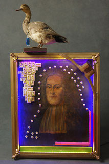Assemblage light art sculpture consisting of an early 19th century painting, a portrait of a Frenchman.  It includes brass letters, brass buttons, plexiglas, antique hanger, and taxidermed duck at the top. It is illuminated with LEDs from 4 sides.