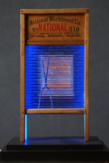 "Assemblage light art sculpture made from an old glass washboard. This sculpture acts almost as a ""light painting"" with plexiglass, lenticular plastic, and LEDs placed in back.  The glass which refracts the light and the appearance of these components."