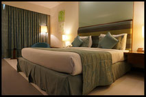 hotel room with comfortable mattress and bedding