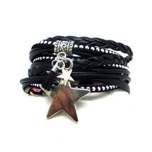 Bracelet bohème ORION noir étoiles et pomponprésenté