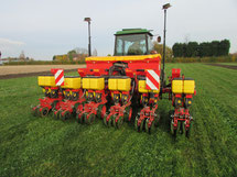 A precision seed drill at work in a clover living mulch.
