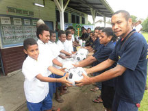 Distributing stationery and sports goods to students for supporting
