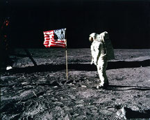 Apollo 11 astronaut Buzz Aldrin poses with the American flag on the surface of the moon in July 1969 (Credit: NASA)
