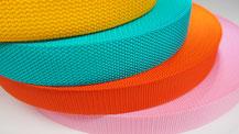 引張強度が高く発色が良い比重の軽い価格の安い細巾織物