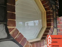 Plantation Shutters in Circle Window