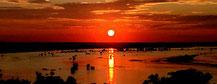 Der Kavango River spiegelt den Abschied