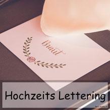 Hochzeits Lettering - Tischkärtchen und Menükarte für eine Hochzeit professionell in Szene gesetzt