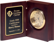 Hand-rubbed rich mahogany finish book clock, gold spun dial, three hand movement.