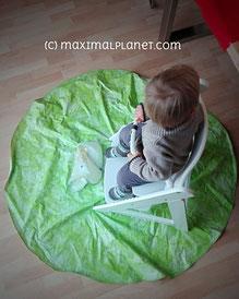 Stuhlunterlage in Form einer PLastickdecke unterm Hochstuhl