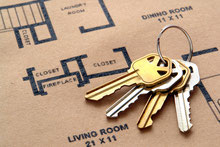 Key ring on top of the floor plan for a house