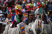 Aryan ladies in traditional dress and flower headwear, Union Territory Ladakh, India