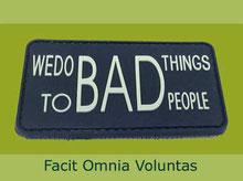 "Button with text ""Facit Omnia Voluntas"""