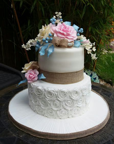 Lilac 4 tier wedding cake with lace and roses