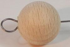 Holzkugel als Schwingkörper mit Energieschleife.