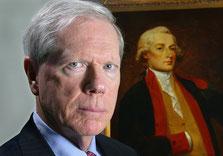 """Prof. Dr. Paul Craig Roberts vor einem Portrait von Alexander Hamilton (1757-1804). """"Alexander Hamilton war der erste Assistant Secretary of the Treasury – ich war der letzte. Seit dem wird das US-Finanzministerium von der Wall Street gesteuert"""