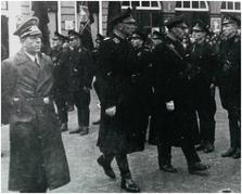 . Münzer bij de installatie van burgemeester C.E.P. Lenshoek op 19 december 1941, Goes