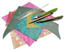 Papier, Lineal und Werkzeug zum Basteln mit Papier