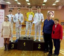 Андрей Виноградов (справа на пьедестале) и тренер Галина Рудьман