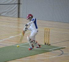 Action shot of Ruan (ZCCC) at the crease