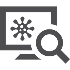 Une loupe inspecte un écran sur lequel un virus stylisé est représenté