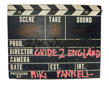 graphic of a vintage clapper-board with the ZakWashington logo