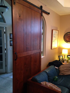 Barn door out of Alder with cast iron handle