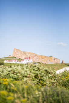 Photo of the pierced rock at Percé in the Gaspé Peninsula in Quebec during the summer taken by Marie Deschene photographer for Pakolla