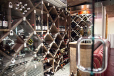 Photo of a cellar full of bottles of wine in the restaurant Le Pois Penché in Montreal taken by Marie Deschene photographer for Pakolla