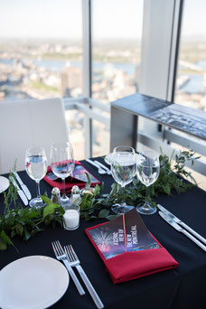 Table with evening view at Sommet Place Ville Marie organized by Tourisme Montréal to promote the city as a tourist destination a must-have photo taken by Marie Deschene photographer for Pakolla