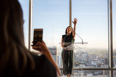A Tourisme Montréal employee calls everyone for presentations during the influencers evening to promote the city as a must-see tourist destination photo taken by Marie Deschene photographer for Pakolla