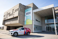 Exterior photo of a 107.3 Red car in front of the Théâtre Desjardins in Lasalle Montreal by Marie Deschene Pakolla