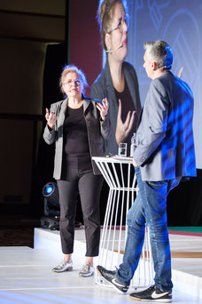Photo of speaker Nadia Seraiocco answering questions from Gaetan Namouric during the annual conference of the Association of Directors and General Managers of Desjardins ADGC caisses at Fairmont Mont-Tremblant by Marie Deschene Pakolla