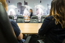 Photo of a Tourisme Montréal conference room with employees taken by Marie Deschene for Pakolla