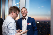 Two representatives of Montreal companies laugh during the evening of influencers organized by Tourisme Montréal to promote the city as an essential tourist destination photo taken by Marie Deschene photographer for Pakolla