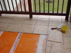 Schluter Ditra is installed under tiles on a patio