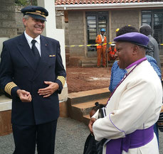 Fokko Doyen and Bishop Timothy Ranji in an in-depth discussion in front of a complex of the John Kaheni Residence.